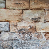 Limestone medieval wall of stone blocks texture background surface empty square closeup Royalty Free Stock Photos