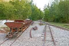 Limestone mine tracks and carts Royalty Free Stock Images
