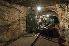 Limestone mine with train and locomotive Stock Photos