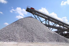 Limestone mining and transportation. A large store of a raw-limestone with belt Stock Photo