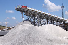 Limestone mining and transportation. A large store of a raw-limestone just from belt Stock Image