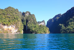 Limestone mountains with green water  in Ratchaprapa dam ,Khaoso Stock Images