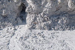 Limestone in natural light diffused water. Mountain of limestone waste in the industrial zone Royalty Free Stock Photography