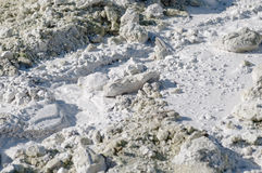 Limestone in natural light diffused water. Mountain of limestone waste in the industrial zone Stock Photos