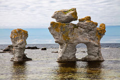 Limestone pillars. In the sea Royalty Free Stock Photo