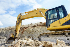 Limestone quarry with earth mover Stock Photos