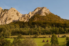 Limestone range with green pastures Royalty Free Stock Photo