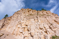 Limestone rock against the blue sky Stock Image