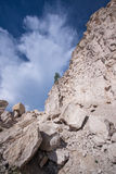 Limestone rock against the blue sky Royalty Free Stock Photos