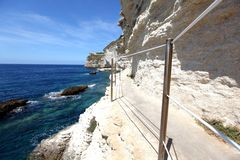Limestone rock cliffs with a walkway Royalty Free Stock Photo