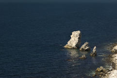 Limestone rock in dark sea water Royalty Free Stock Photos