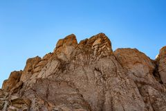 Limestone rock in Egypt. Close up limestone rock against blue sky in Egyptian desert stock photos