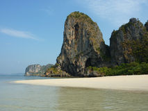 Limestone rock and exotic beach Stock Photography