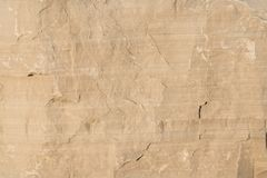 Limestone rock face geology wallpaper background. Weathered limestone rock face geology wallpaper background, showing sedimentary geologiccal strata stock image