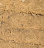 Limestone rock face geology wallpaper background. Weathered limestone rock face geology wallpaper background, showing sedimentary geologiccal strata Stock Photography