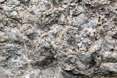 Limestone rock with fractures. Fractured limestone crossed by calcite veins Royalty Free Stock Image