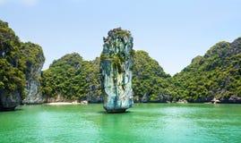 Limestone rocks and calm sea of Halong bay, Vietnam stock photography