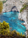 Limestone Rocks. The entrance to the cave and clear turquoise sea royalty free stock images