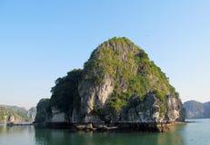 Limestone rocks in the sea bay stock image