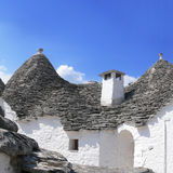 Limestone Roof of a Trullo with chimney in Alberobello Italy Stock Images