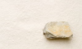 Limestone on sand Stock Image