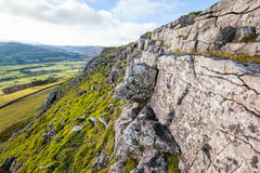 Limestone Scar in the Yorkshire Dales. Rocky cliff with weathered limestone on Stags Fell in the Yorkshire Dales, England. Valley of Wensleydale can be seen in Stock Photos