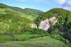 Limestone sinkhole in the mountains Royalty Free Stock Photos