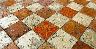 Limestone square tiles. Tessellation chessboard Royalty Free Stock Photos