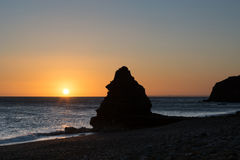 Limestone Stack on the beach at sunrise Royalty Free Stock Photo