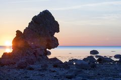 Limestone stack with calm ocean in the background stock photo
