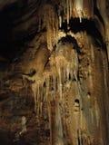 Limestone stalactites drip in strange formations Stock Photo