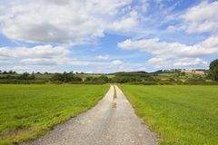 Limestone track and patchwork fields Stock Photos