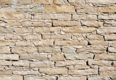 Limestone wall on a bright sunny day Royalty Free Stock Photos