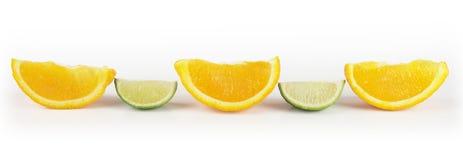 Limette et parts oranges Photos stock