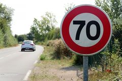 Limit speed at 70 km/h on the french roads. A limit speed at 70 km/h on the french roads stock photos