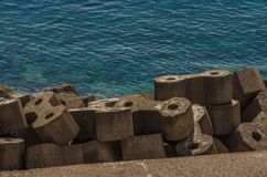 Limitation with stones at the sea. Limitation with big concrete stones at the sea Stock Photography
