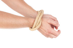 Limitation of movement at the hands tied with a rope. The man Royalty Free Stock Photos