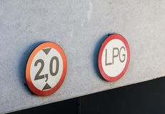 Limitation signs. Limitation sign by a garage entrance Royalty Free Stock Images