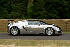 Limited edition bugatti veyron pur sang. Aluminium limited edition bugatti veyron pur sang on track at goodwood festival of speed Royalty Free Stock Images