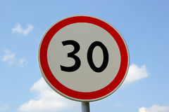 Limited speed. 30 limit with blue sky stock image