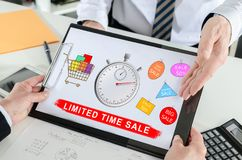 Limited time sale concept on a clipboard. Limited time sale concept shown by a businessman Royalty Free Stock Images