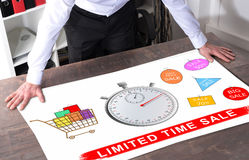 Limited time sale concept on a desk. Man watching a limited time sale concept placed on a desk Royalty Free Stock Image