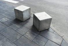 Limiter on pedestrian sidewalks hemisphere from car parks.Cubes. Limiter on pedestrian sidewalks hemisphere from car parks.Cubes royalty free stock photo