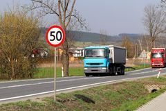 Limiting the speed of traffic to 50 km/h. Road sign on the highway. safety of traffic. Motor transportation of passengers and carg. Oes. Modern cars. A large Stock Photography