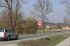 Limiting the speed of traffic to 50 km/h. Road sign on the highway. safety of traffic. Motor transportation of passengers and carg. Oes. Modern cars. The car is Royalty Free Stock Images