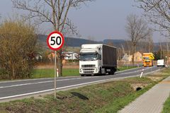 Limiting the speed of traffic to 50 km/h. Road sign on the highway. safety of traffic. Motor transportation of passengers and carg. Oes. Modern cars. A large Royalty Free Stock Images