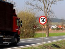 Limiting the speed of traffic to 50 km/h. Road sign on the highway. safety of traffic. Motor transportation of passengers and carg. Oes. Modern cars. A large Stock Images