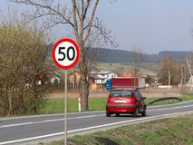 Limiting the speed of traffic to 50 km/h. Road sign on the highway. safety of traffic. Motor transportation of passengers and carg. Oes. Modern cars. The car is Stock Photo