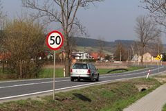 Limiting the speed of traffic to 50 km/h. Road sign on the highway. safety of traffic. Motor transportation of passengers and carg. Oes. Modern cars. The car is Royalty Free Stock Image