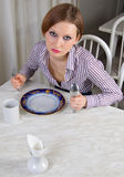 Limits. A hungry girl with an empty plate. It limits herself to the food Stock Photography